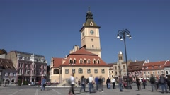 ULTRA HD 4K Timelapse Sfatului Square Brasov downtown busy pedestrian people day Stock Footage