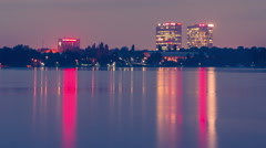 Dusk holy grail sunset timelapse day to night over lake reflecting Stock Footage