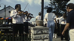 Hungary 1983: violinist playing at the entrance of a restaurant Stock Footage