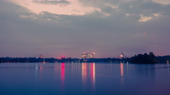 Sunset timelapse day to night over lake reflecting dusk holy grail Stock Footage
