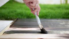 Wood painting with a brush Stock Footage