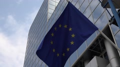 ULTRA HD 4K European flag blow blue yellow stars sunny day modern building icon Stock Footage