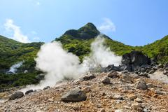 Owakudani valley ( volcanic valley with active sulphur and hot springs in hak Stock Photos