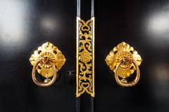 close up of door in asakusa temple with flower pattern at tokyo , japan - stock photo