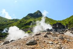 owakudani valley ( volcanic valley with active sulphur and hot springs in hak - stock photo