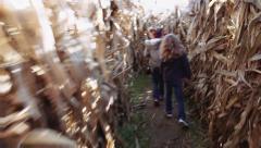 Two little girls running through a corn maze Stock Footage