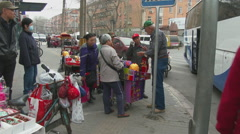 Street vendors sell to American tourist Stock Footage