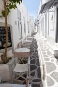 Narrow street with traditional white houses in parikia, paros, greece Stock Photos