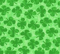 Stock Illustration of shamrocks scattered on a green swirl background
