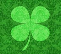 Stock Illustration of shamrock on green damask