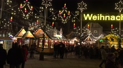 4k Beautiful Christmas market in historic city center with church Stock Footage
