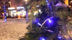 Christmas tree branch decoration on city close up  background Stock Footage