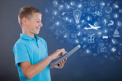 young boy using tablet,school learning or technology concept - stock photo