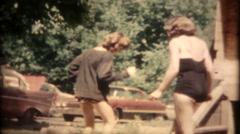 1379 - girls dance the new steps in beachwear - vintage film home movie Stock Footage