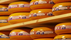 Cheese wheels on shelves Stock Footage