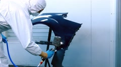 Car fender painting process in camera Stock Footage