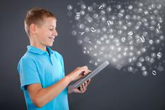 Young boy using tablet,school learning or technology concept Stock Photos