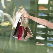 hands holding shopping bags - stock photo