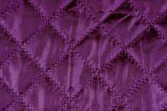 Purple quilted cloth texture Stock Photos
