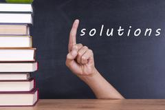hand up with the answer and solution - stock photo