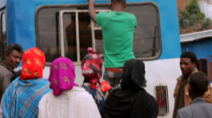 Goods being unloaded from a bus at a local market Stock Footage