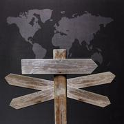 Sign with world map with many directions to travel Stock Photos