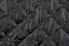 Black quilted cloth texture Stock Photos