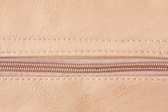 beige zipper on leather cloth - stock photo