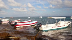 MEXICO, CANCUN - 16 NOVEMBER 2014: Fishing boats near the  wooden pier Stock Footage