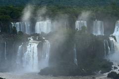 iguazu waterfall in south americal tropical jungle with a massive flow of wat - stock photo