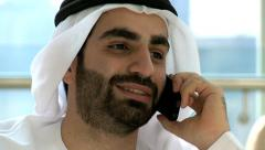 Emirati Arab male kandura business insurance trade growth smart phone technology Stock Footage