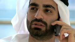 Arab business male smart phone technology stocks shares broker market trading Stock Footage