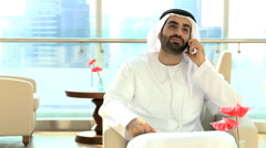 UAE Arabic businessman male national dress property real estate smart phone - stock footage