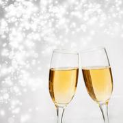 Champagne glasses against holiday lights Stock Photos