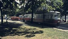 Vienna 1983: tram passing in Burgring Stock Footage