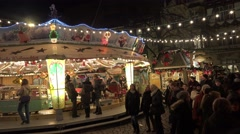 4k Carousel at Christmas market in historic city with cathedral Stock Footage