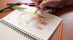 Artist's hand draws a picture of blonde girl hair coloring Stock Footage