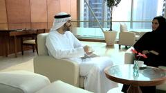 Arab male female kandura abaya leisure UAE hotel travel visitor custom coffee Stock Footage
