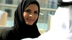 business male female Arab teamwork Dubai finance banking wealth national dress - stock footage