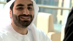 Business male female Arab teamwork Dubai finance banking wealth national dress Stock Footage