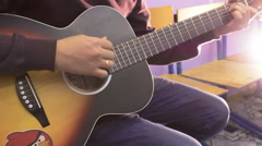 Playing on accoustic guitar Stock Footage