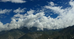 4k timelapse puffy clouds mass rolling over Tibet mountaintop,roof of the World Stock Footage