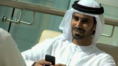Arabic male business Gulf Region city insurance growth smart phone technology Stock Footage