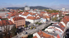 Aerial - Old part of the Ljubljana city with river channel through it Stock Footage