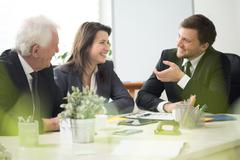 People laughing during business appointment Stock Photos