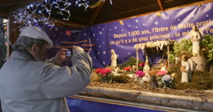 Man photographing nativity scene at Paris Christmas Market Stock Footage
