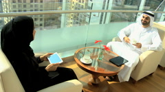 male female Emirati UAE lifestyle vacation relaxation traveller tourism tablet - stock footage
