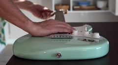 Person tuning and fixing electric guitar Stock Footage