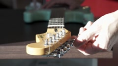 Fine tuning an electric guitar  Stock Footage