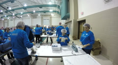360 degree time lapse video of 100's of volunteers packing food for poor. Stock Footage